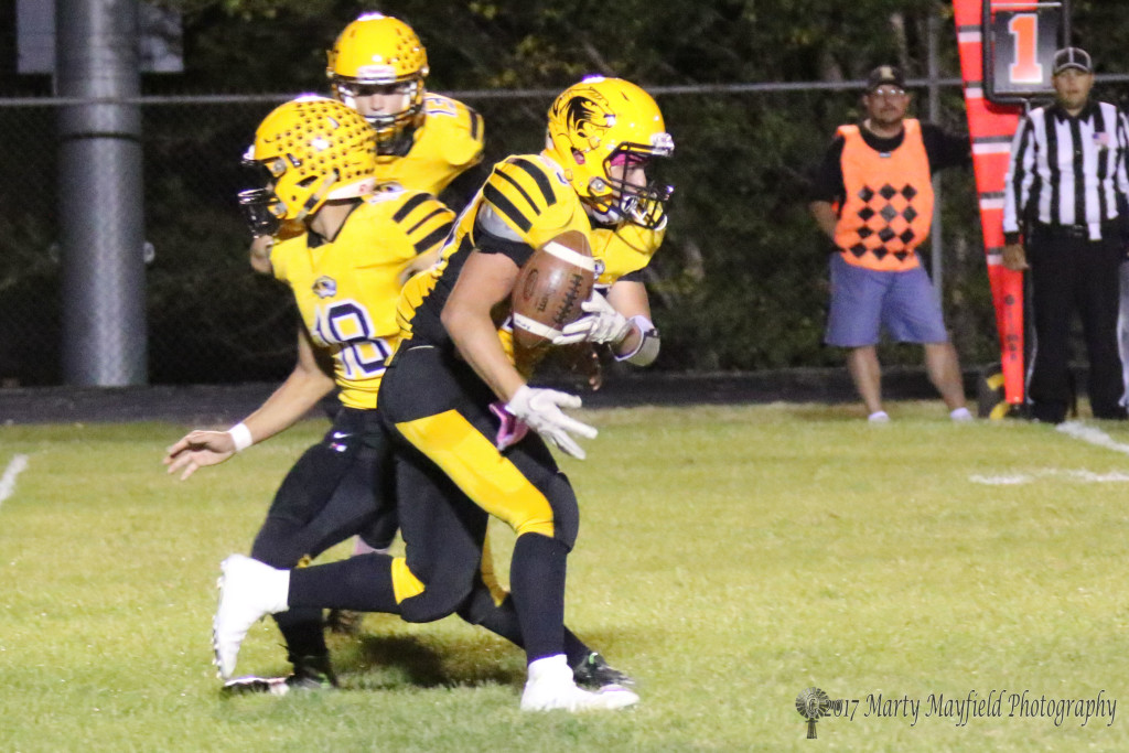 Tristen Gallegos just gets the handoff from Dustin Segura, he will finally get his hands on the ball before being wrapped up by the Clayton Defense but not before gaining a few yards on the play.