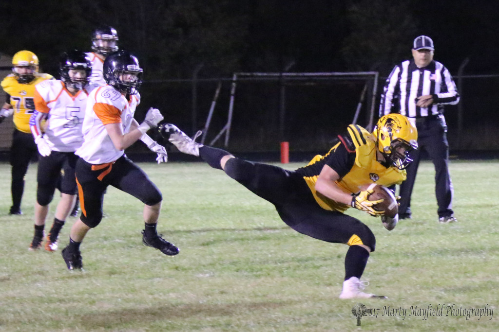 After that amazing grab Nathaniel Tarbox manages to maintain control and get Raton another first down Friday night.