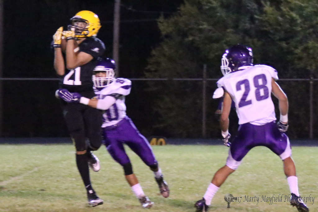 Gabe Martinez became one of Dustin Segura's favorite receivers Friday night as he brings this one in under pressure from Genaro Zitz