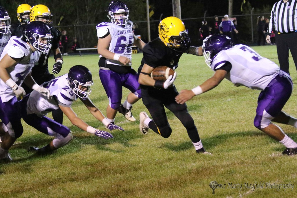 Richie Acevedo struggled most of the night agains the Lion Defense but when he did break away he made long yardage.