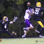 Almost an interception by Daniel Esquivel as the pass goes through Gabe Martinez hands in the second half of the district game with Santa Rosa Friday night in the Jungle