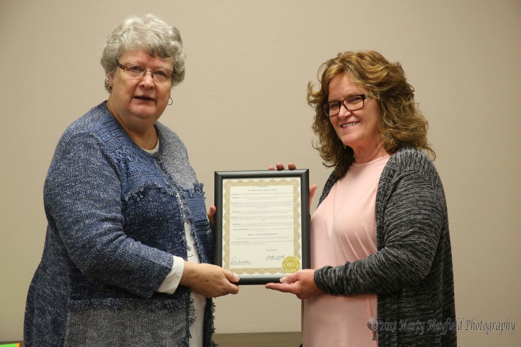 Jami Esquivel accepted the proclamation for breast cancer awareness month from Mayor Sandra Mantz