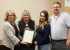 Commissioner Lindé Schuster presented the Proclamation for Domestic Violence Awareness Month to Janis Stuart, Victoria Gonzales and Lee Phillips.