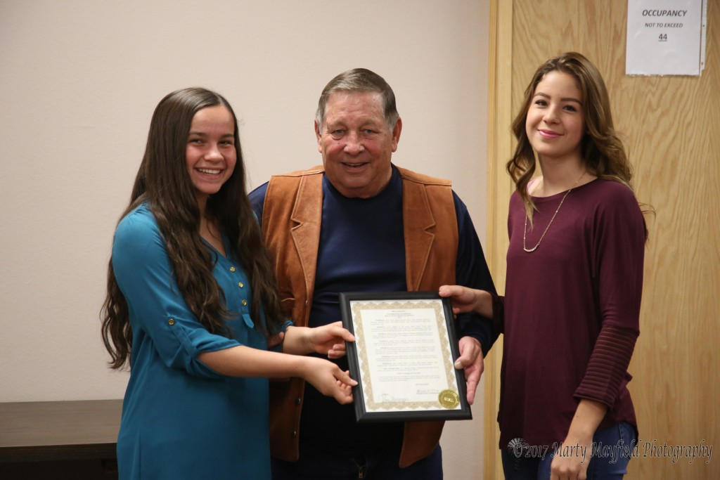 Baylor Walton and Montan Martinez were on hand to accept the proclamation from Commissioner Ron Chavez for their efforts at the state track meet last spring where they not only won their races, they set new school speed records.