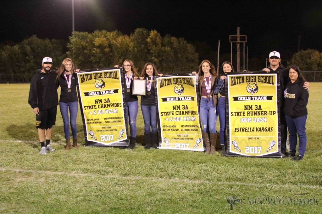 Coach Justin Milano, Alina Pillmore, Regan Snow, Baylor Walton, Montana Martinez, Estrella Vargas, Coach Brock Walton and proud mom Ashley Walton were on hand Friday night to accept the proclamation for the girls state wins.