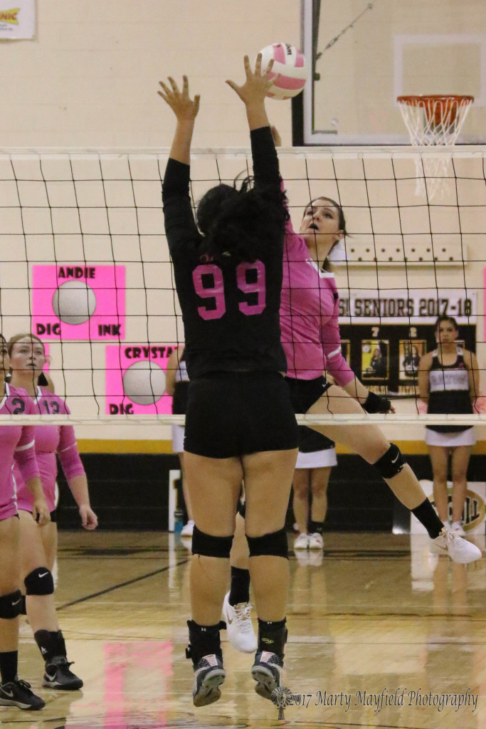 Camryn Mileta slams one over the net as Natalie Nathanson goes up for the block, a scene that played out several times during the 5 game match with Desert Academy Thursday evening.