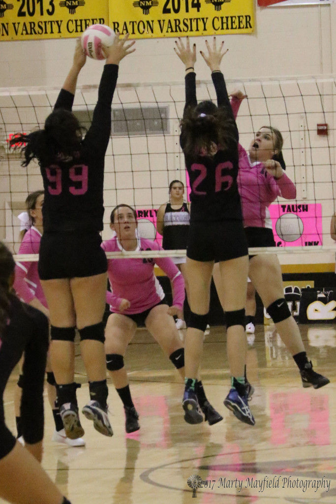 Natalie Nathanson gets the block on the spike from Kerrigan Weese Thursday evening in Tiger Gym.