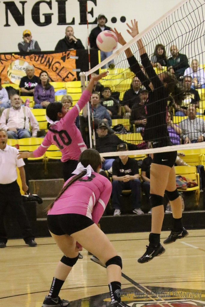 Michaela Glinsky stuffs the Autumn Archuleta spike back over the net, a problem the Lady Tigers ran into several times during the match with Desert Academy Thursday evening in Tiger Gym.