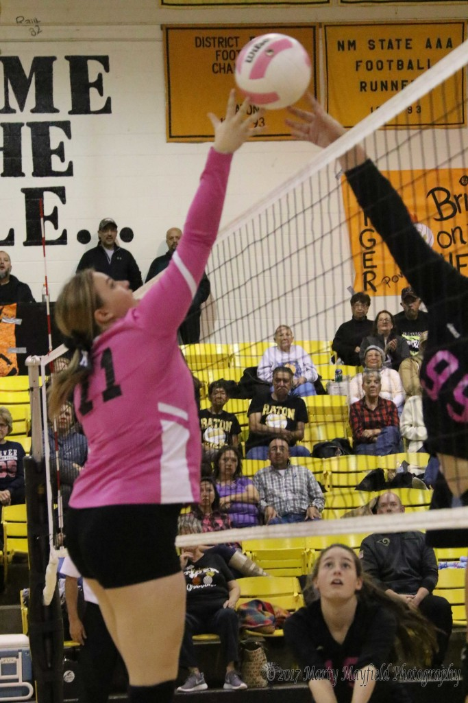Kerrigan Weese and Natalie Nathanson meet at the net as Weese's ball gets tipped back at her during the Match with Desert Academy Thursday evening in Tiger Gym.