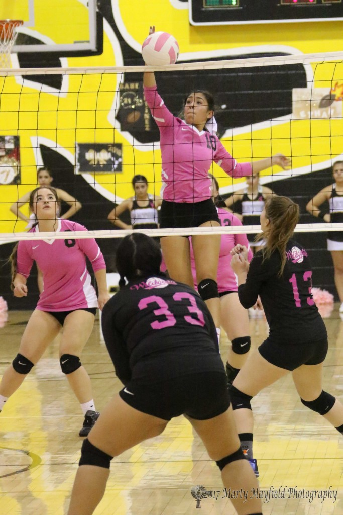 Autumn Archuleta spikes the ball over the net with no opposition, a rarity during the district match Thursday evening.