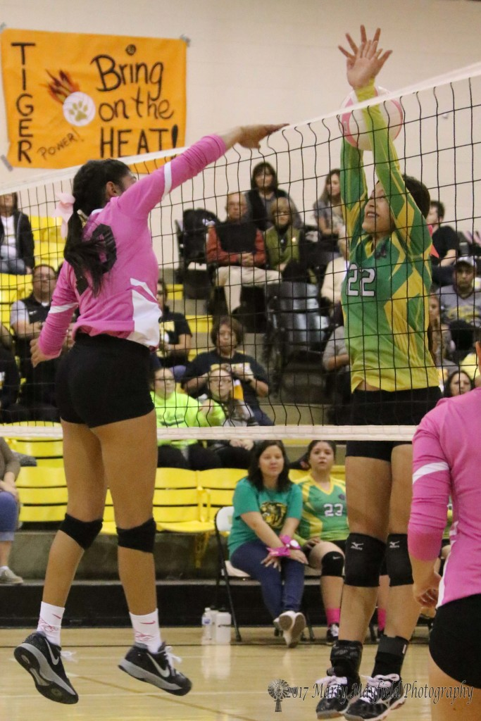 Autumn Archuleta slams one past Faith Flores during game 2 of the district match with Pecos Saturday afternoon.