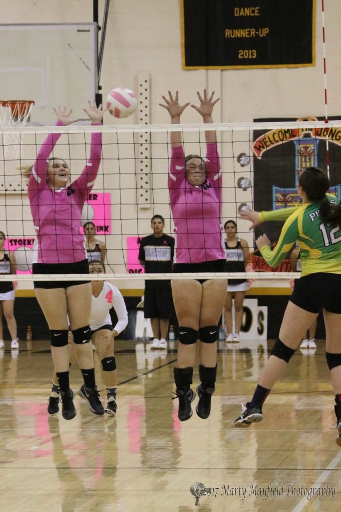 Kerrigan Weese and Jadyn Walton go up for the block as they did many times Saturday afternoon in the district match with Pecos in Tiger Gym Saturday afternoon.