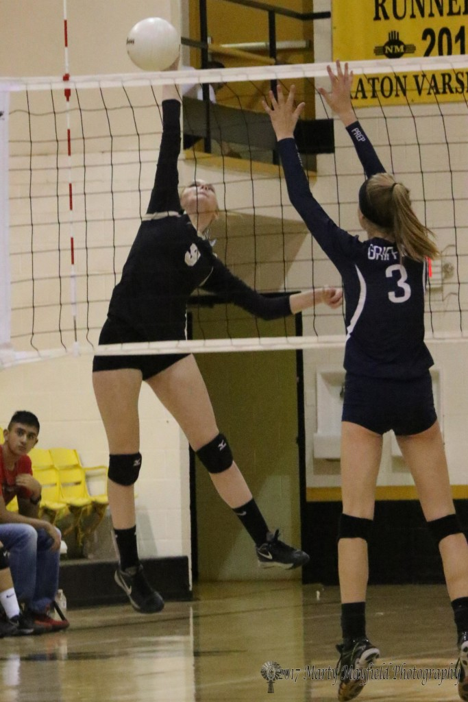 Ginger Baird gets up for the spike as Samantha Wilson goes for the block during the third game of the match with Santa Fe Prep Saturday afternoon in Tiger Gym.