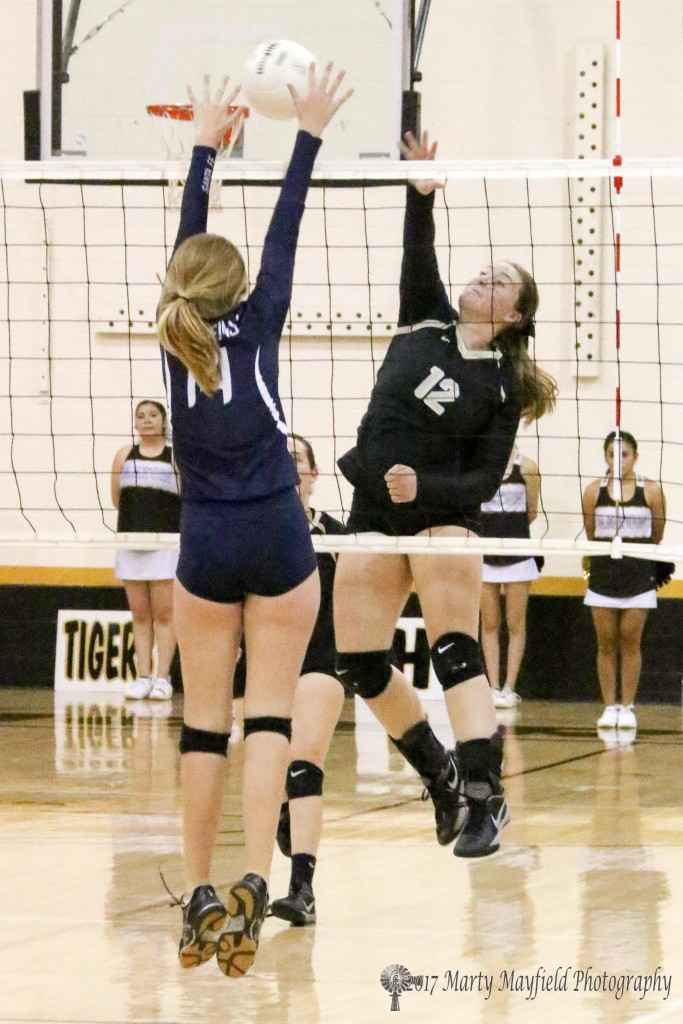 Jadyn Walton slams the ball over the net only to bet met by India Cunningham Saturday afternoon in Tiger Gym.