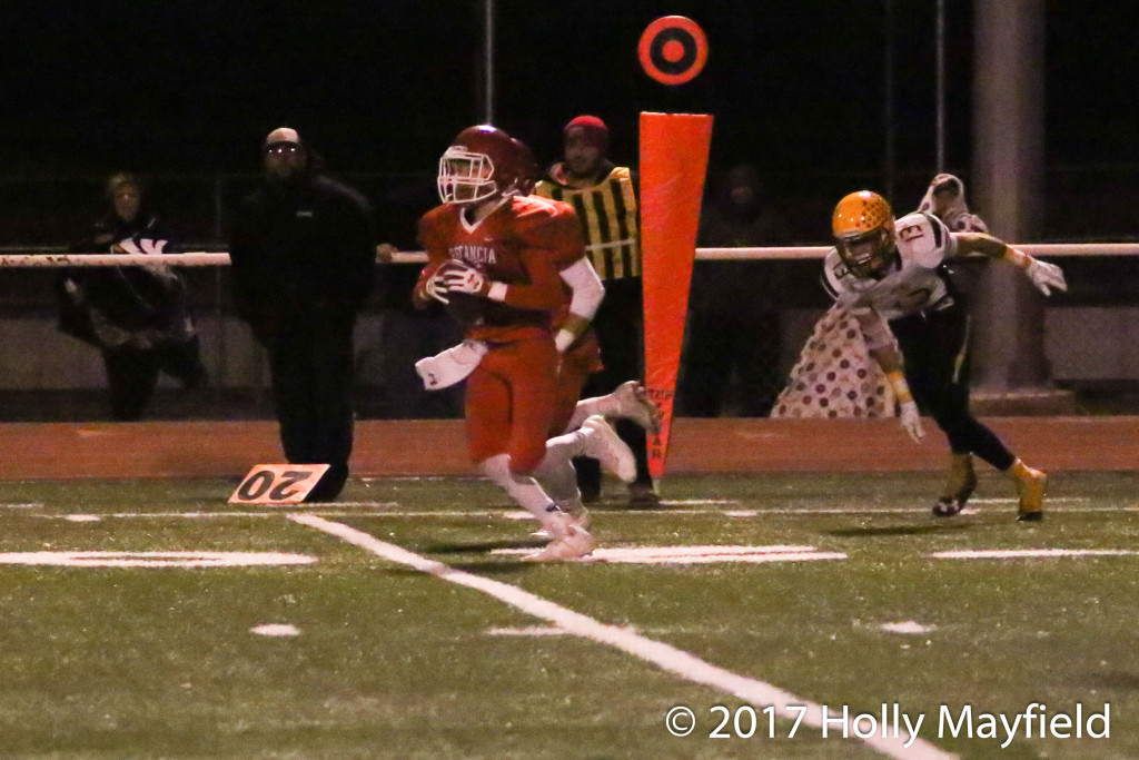 Garrett Noblitt picks off a Dustin Segura pass one of several turnovers in the state playoff game in Estancia Friday night.