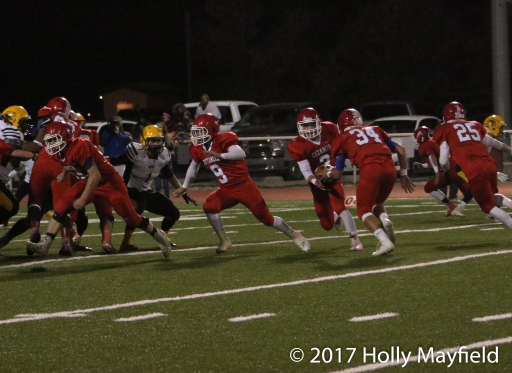 Josh Thomas takes the handoff from Cruz Moreno, Moreno and Thomas often lined up side by side in the backfield making the defense guess who the snap would go to during the state playoff game Friday night.