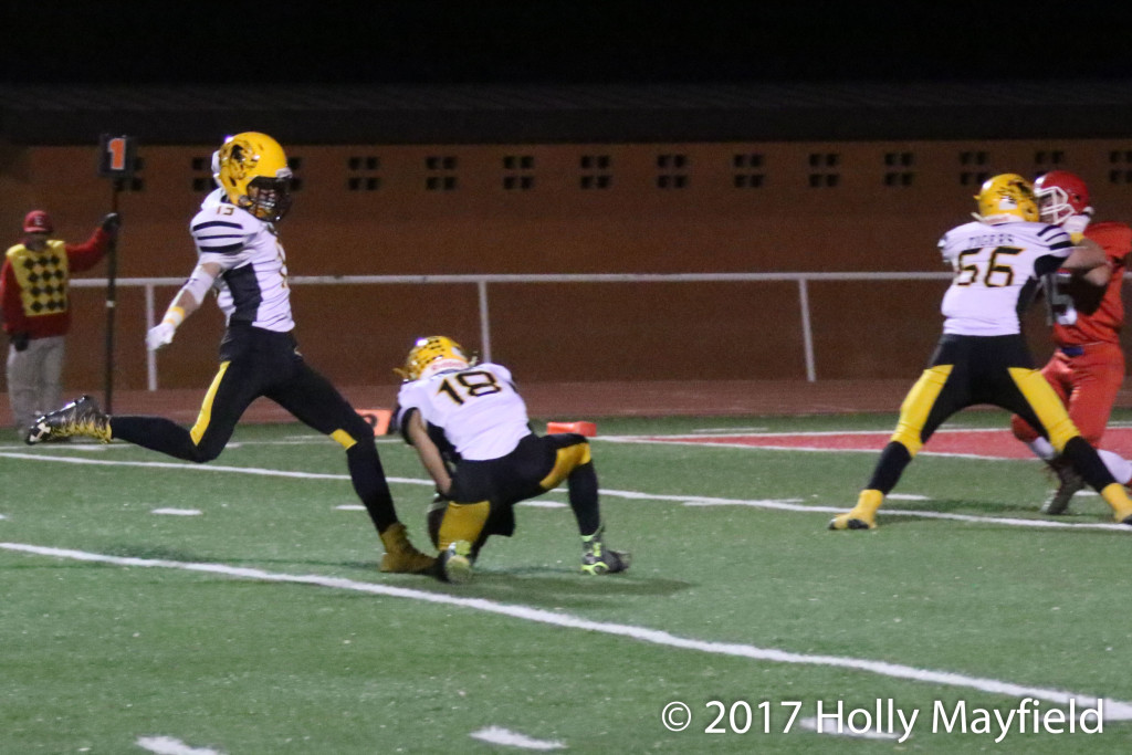 Aden Vanderwater adds the extra point to one of the two TDs Raton managed to score in the wind blown state playoff game Friday night in Estancia.