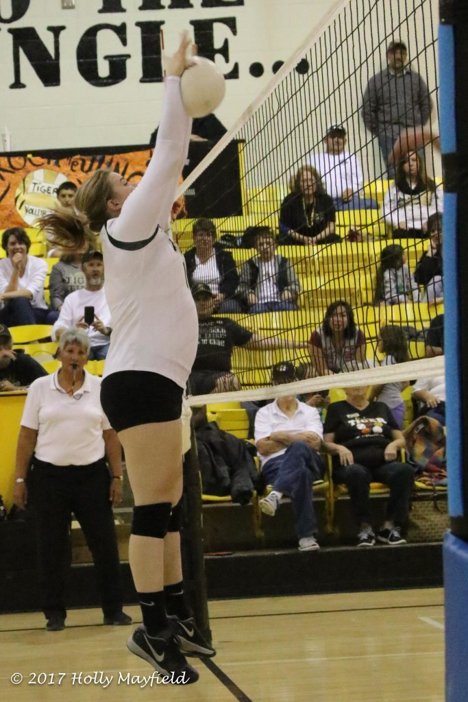 Kerrigan Weese played strong at the net all night long for the Lady Tigers getting the block on this spike during the District Championship match in Tiger Gym.