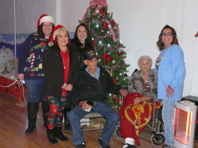 Left to right: Raton Main Street members, Jessica Barfield, Diana Sanchez (President), Brenda Ferri (Executive Director) and Trish Romero; seated Virgil and Virginia Buscarini