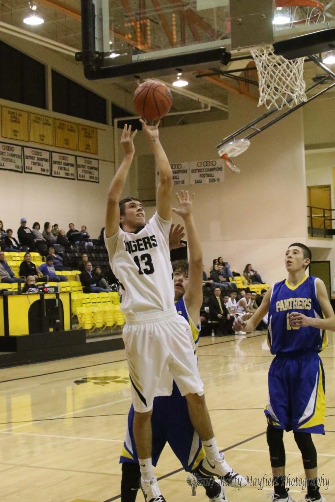 Aden Vanderwater goes in for the easy shot and two of his 21 points on the evening against Peñasco Tuesday evening.
