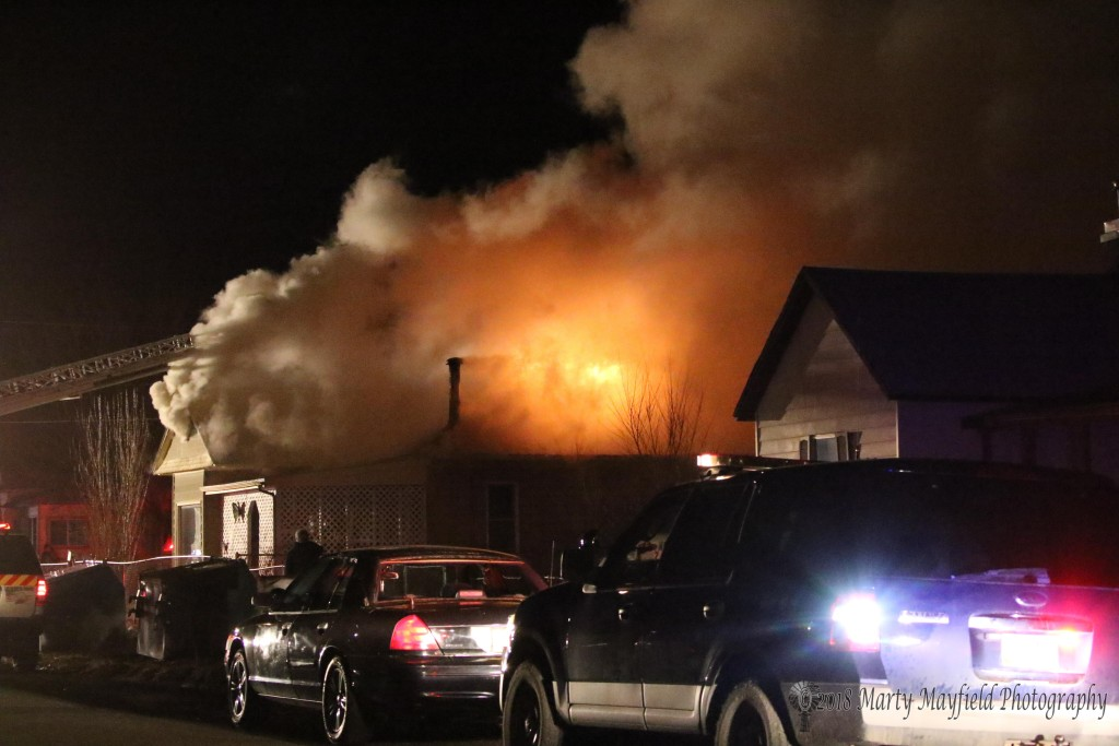 Flames exit the roof of this house at North 2nd St. and Tinaja just after 7:00 p.m.