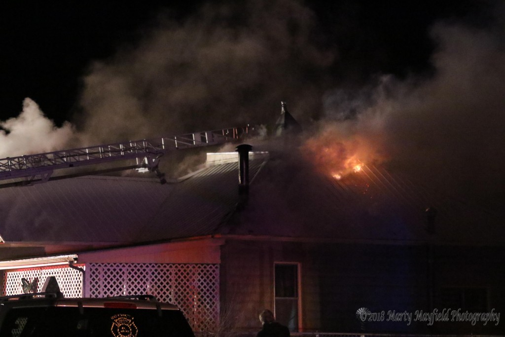 Flames subsided as Raton Fire Fighters work to extinguish the fire at this house on North 2nd and Tinaja Sunday evening.