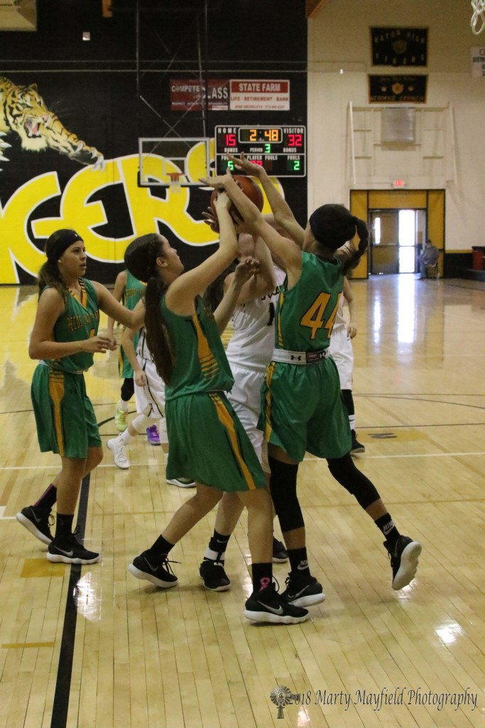 Neveah Ortiz gets tied up in the crowd as she tried to go up for the shot, Savanah Ortiz (44) got both hands on the ball.