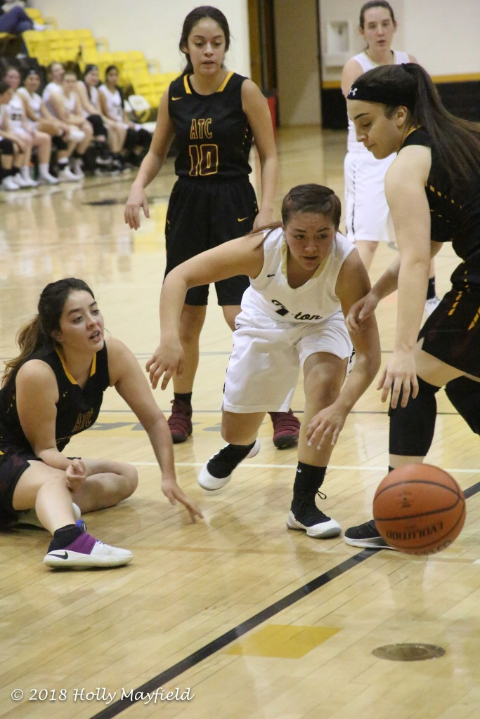 Felicity Sealy knocked ball out of Andie Ortega's bounce and Andie Ortega goes after it in the second quarter of the game with ATC Saturday evening.