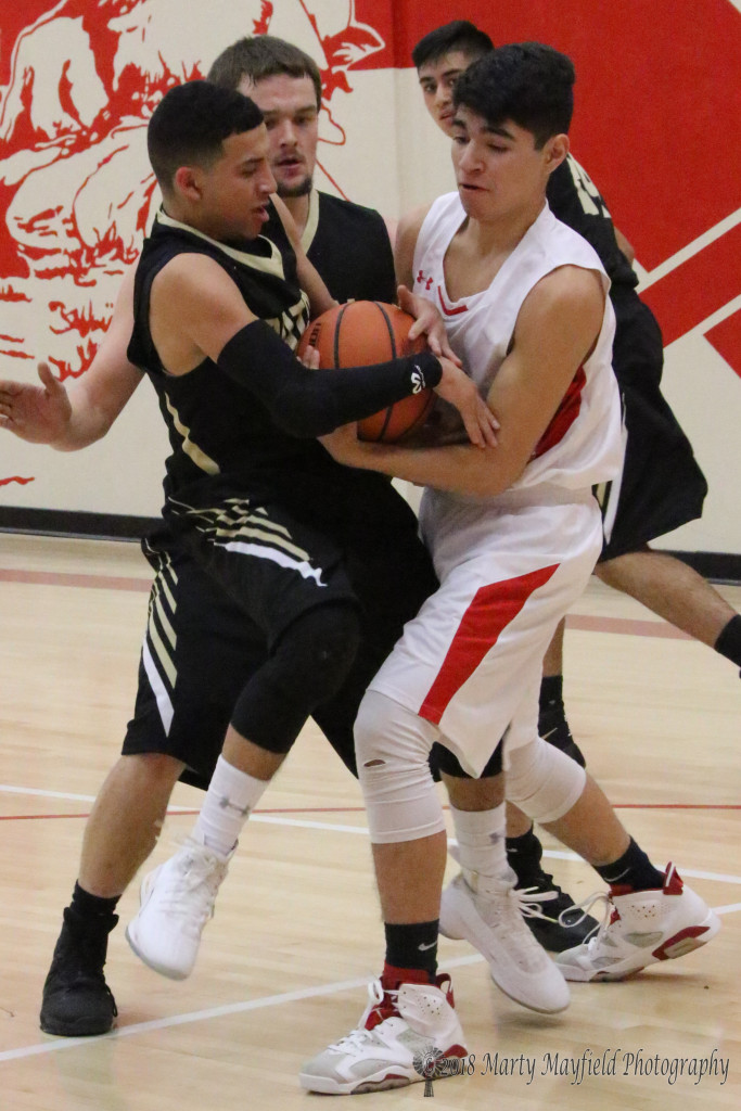 Richie Acevedo and Anthony Waggoner struggle for the ball during the first half of the game in Cimarron Thursday evening.