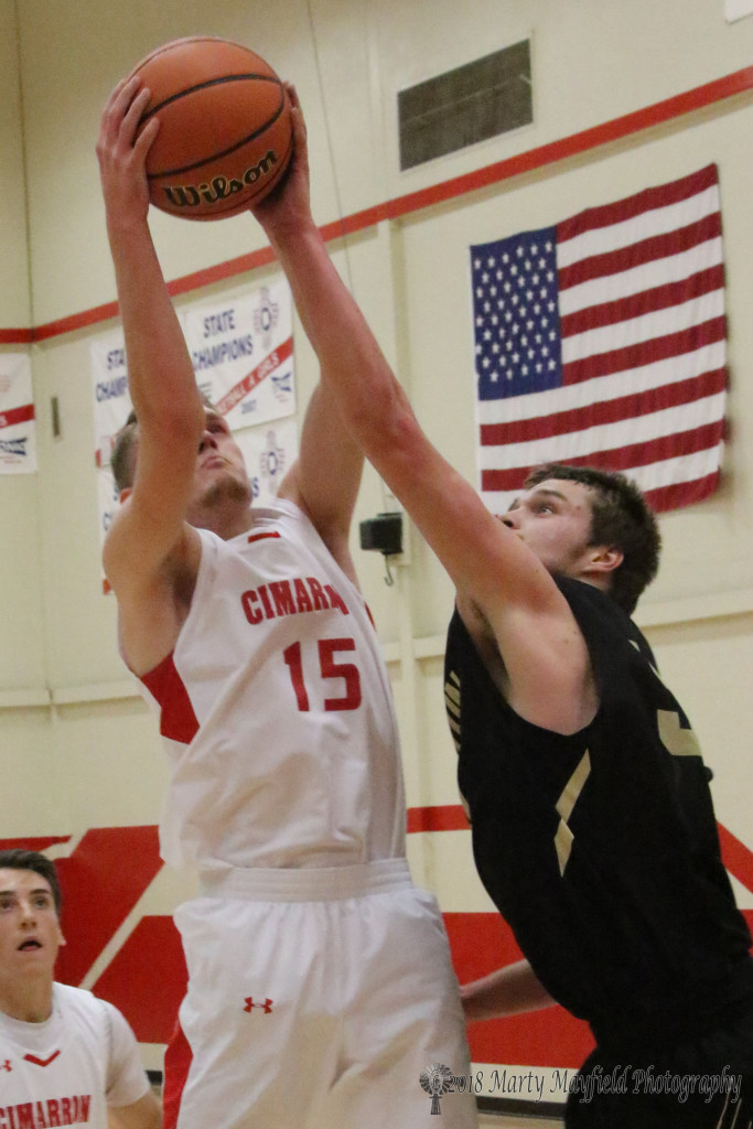 Nathaniel Tarbox and Noah McDonald go for the rebound Thursday evening in Cimarron.
