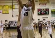 Gabe Martinez takes the ball to the hoop in the second quarter of the district game with ATC Thursday evening.