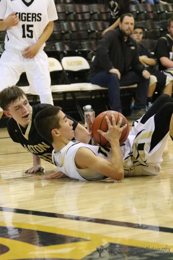 Reyes Aragon and Seth Rubio on the floor during the JV game Saturday afternoon as part of TigerFest 2018.